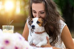 Young, beautiful girl has received a long-awaited gift - dog bre Kuvituskuvat