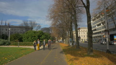 People walking on Savska Cesta street near Mimara Museum, Zagreb - stock footage