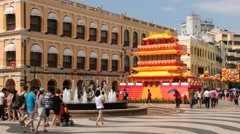 People walk by the Senate square in the historical part of Macau, China. - stock footage