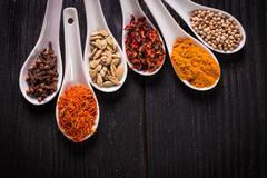 spices and herbs on wooden table , medicinal concept - stock photo