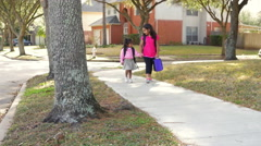 Two cute Indian children walking to school Stock Footage