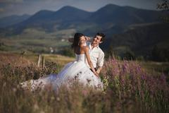 Romantic fairytale couple newlyweds kissing and embracing on a background of - stock photo