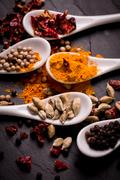 Spices and herbs on wooden table , medicinal concept Stock Photos