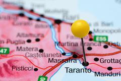 Taranto pinned on a map of Italy - stock photo