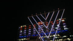 Tel-Aviv municipality lit up with Hanukah menorah 8 candles, low right angle Stock Footage