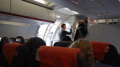 Flight attendants stewards prepares flight for takeoff - stock footage