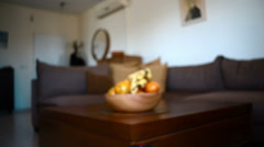 Dolly in to fruit bowl with banana and oranges on living room coffee table Stock Footage