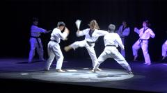 Epic martial arts show, battle, woman fights men, Taekwondo South Korea Stock Footage