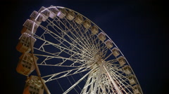 Idle Ferris wheel with lights, nighttime Stock Footage