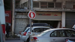Stop sign in poor neighborhood, people and cars, South Tel-Aviv, Israel Stock Footage
