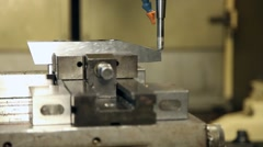Cnc milling machine work on aluminum piece Stock Footage