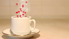 Cup of coffee with steam and hearts. Stock Footage