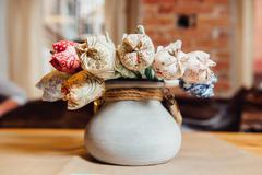 Colorful artificial flowers made from cloth Stock Photos