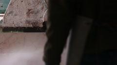 Worker watching industrial saw sawing huge block of marble, slider shot Stock Footage