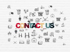 Business concept: Contact us on wall background - stock illustration