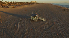 Aerial shot of lifeguard house in Santa Monica beach - Los Angeles Stock Footage