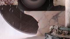 Saw blade sawing marble stone block Stock Footage