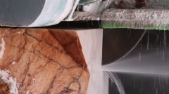 Close up industrial saw sawing block of marble Stock Footage