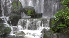 Beautifully decorated artificial waterfall, traditional Asian setting, Taiwan - stock footage