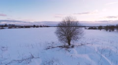 Aerial footage at low altitude flight. Winter landscape. Sunset. Camera around. - stock footage
