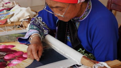 Elderly Ethnic Chinese Woman Embroidering Stock Footage
