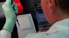 Male Lab Technician Applying Samples into Test Tubes Stock Footage