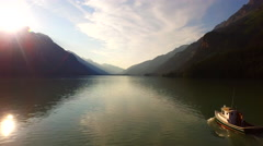 Cute Little Cabin Cruiser in Mountain Lake with Sunburst Alaska 4K Stock Footage