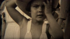 1937: Cute girl in leather cowboy hat wipes sweat from face bends hat. TRYON, NC Stock Footage