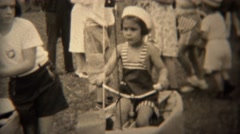 1938: Kids in naval sailor hats riding bikes in patriotic American parade. Stock Footage