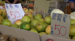 Price tags for oranges at local fruit vegetable market Taipei, Taiwan Stock Footage