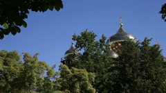 Orthodox (Russian) church golden domes and crosses on blue sky. Stock Footage