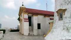 View to the old lighthouse and chapel in Macau, China. Stock Footage