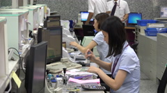 Asian bank employees at work in an office in Taipei, Taiwan - stock footage