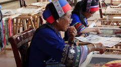 Yi Ethnic Minority Women Sewing Decorative Pictures - stock footage