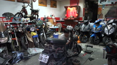 Local motorbike repair workshop in Taipei, mechanic, garage, Asia, Taiwan Stock Footage