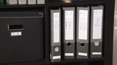 Camera pan on boxes in office cupboard - stock footage