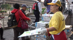 Taiwan press freedom, democracy, handing out free newspapers to commuters Stock Footage