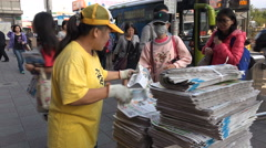 Asia, Taiwan streets, free newspapers, press freedom, morning rush hour Stock Footage