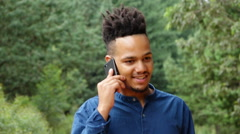 Stock Video Footage of African or African American man talking on cellphone