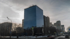 Moscow winter street and mirror building timelapse in cloudy weather Stock Footage
