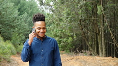 African or African American man talking on cellphone - stock footage