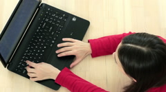 High angle view of a young woman using her laptop HD Stock Footage