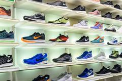 Nike Running Shoes For Sale In Nike Shoe Store Display - stock photo