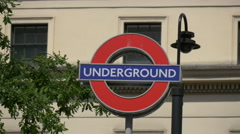 Underground sign on the street in London Stock Footage