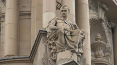 Man statue on the English National Opera in London Stock Footage