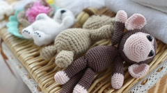 Knitted baby animal toys are in a wicker basket Stock Footage