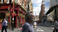 People walking on Lisle Street in London - stock footage