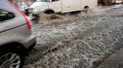 Cars driving on the flooded streets of water, flooding the road. Stock Footage
