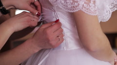 The bride dressed in wedding gowns Stock Footage