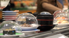 Fresh Japanese sushi dishes on conveyor belt, food court, restaurant Taipei Stock Footage